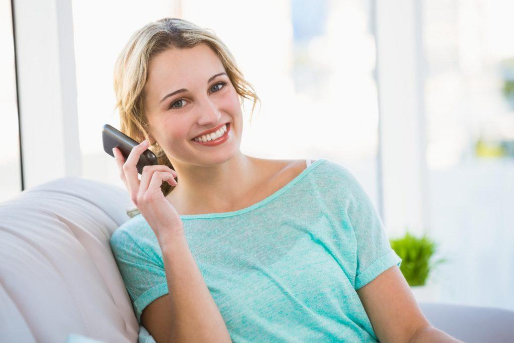 woman smiling taking phone call