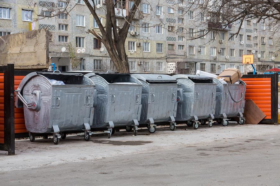 rental dumspters behind buildings