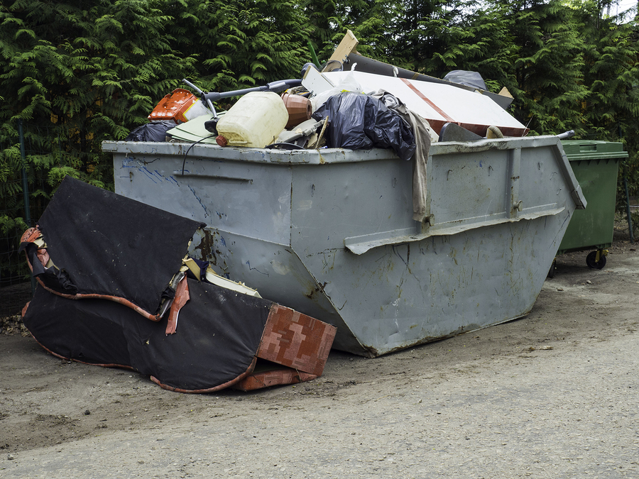 rental dumpsters filled of trash